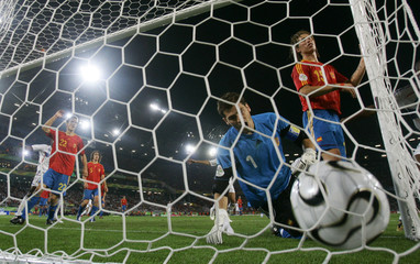 Spain's Casillas and Ramos react to letting in a goal from France's Vieira during their second round World Cup 2006 soccer match in Hanover