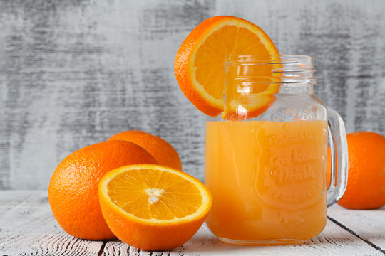 non-alcoholic blood orange cocktail in a glass jar on a wooden background