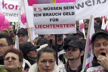 Public working employees attend a demonstration in Dortmund