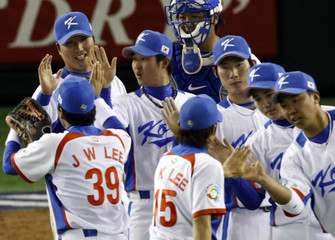 South Korea's Lee celebrates with teammates after defeating Taiwan during the WBC Tokyo round in Tokyo