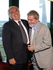 Brazil's President  Lula da Silva and  de la Sota, Governor of the Argentine province of Cordoba, laugh during their meeting in Brasilia
