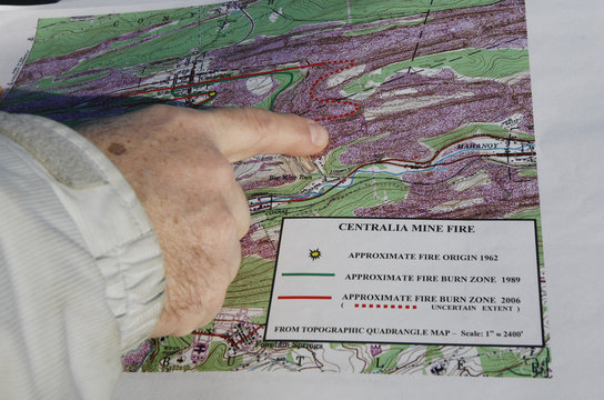 Tim Altares, manager of the division of mine hazards for the Pennsylvania Department of Environmental Protection (DEP) points to a map showing the extent of an underground coal mine fire in Centralia, Pennsylvania