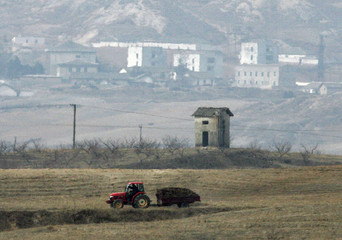 Farm tractor moves along farm road in Gijungdong propaganda village in this picture taken from South Korean observation post at truce village of Panmunjom in DMZ separating two Koreas in Paju