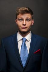Buisness man in suit over dark background