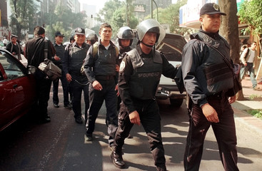 MEXICO CITY RIOT POLICE LEAFD AWAY ARRESTED DEMONSTRATING COLLEAGUES.