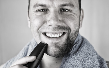monochrome textured portrait bearded man shaving