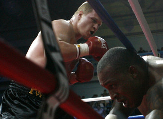 Alexander Povetkin of Russia looks at Taurus Sykes of the U.S. during their IBF boxing fight in Chekhov