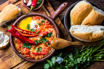 """Traditional chilean dish """"spicy hot"""" -- """"picante caliente"""" eggs with chili, tomatoes and onion"""
