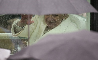 Pope Benedict XVI waves to faithful as he leaves at the end of a mass at Plebiscito square in Naples