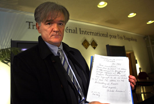 Lawyer for the late Yugoslav president Milosevic displays a handwritten letter by Milosevic in The Hague