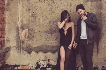 Sexy girl and bearded man smoking with wine