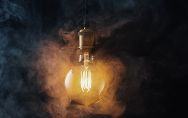 Vintage hanging light bulb with smoke