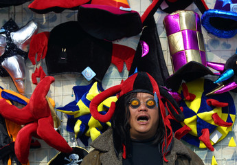 VENDOR SELLS FUNNY MASKS AND HATS DURING THE CHINESE NEW YEAR INBEIJING.