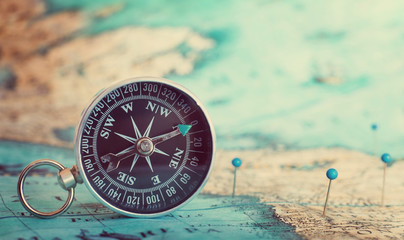 Fototapete - Compass on map.