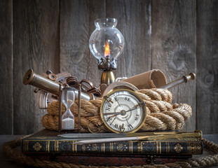 Fototapete - Exploration and nautical theme grunge background. Compass, telescope, sextant, divider and rope on wood desk.