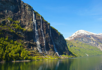 Waterfalls of Geirangerfjord in Norway. The beautiful mountain scenery.