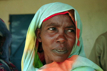 Darfur refugee Halime Ache waits for her monthly food ration at a distribution centre in Gaga refugee camp, eastern Chad