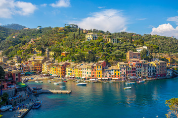 PORTOFINO, ITALY, APRIL 8, 2017 - Panoramic view of Portofino, an Italian fishing village, Genoa province, Italy. A tourist place with a picturesque harbour and colorful houses