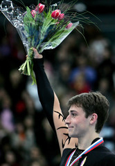 France's Joubert stands on the podium during the victory ceremony at the ISU Grand Prix of Figure Skating final in St. Petersburg