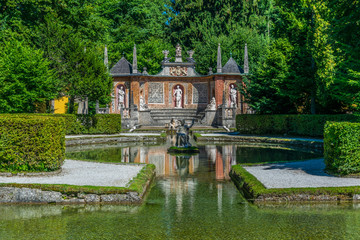 View of a trick fountain situated in a public park near the Hellbrunn Palace, Salzburg, Austria.
