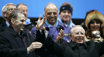 Italian President Ciampi waves beside Rogge during opening ceremony of Winter Olympic Games