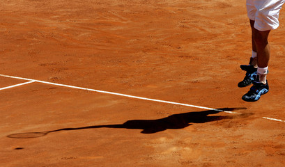 Roddick of the US serves the ball during his tennis match against Costa of Spain at the Italian ...