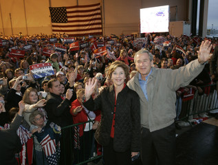 US President Bush and first lady Laura arrive at a campaign election rally in Wilmington.