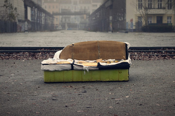 Old sofa in a dirty City