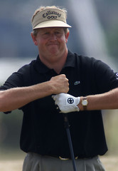 MONTGOMERIE TWISTS HIS GRIP AT THE BRITISH OPEN GOLF CHAMPIONSHIPS.