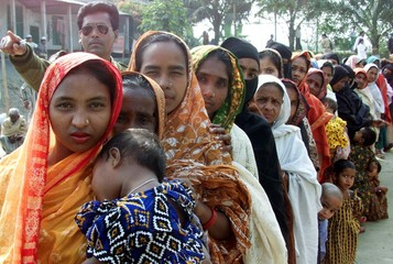 BANGLADESHI VOTERS QUEUE TO CAST THEIR VOTES IN LOCAL COUNCIL POLLS INSINGAIR.