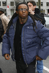 Rapper Lil Wayne arrives for a pre-sentencing hearing in a firearms possession case in New York