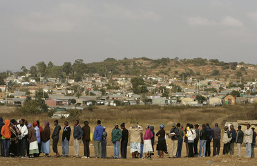 Voters queue at a polling station in Freedom Park informal settlement, Soweto