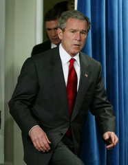 US PRESIDENT BUSH ARRIVES WITH SENATOR ROBB FOR BRIEFING ON IRAQ WMD INTELLIGENCE PANEL.