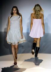Models display outfits created by Roberto Torretta at Pasarela Cibeles fashion show in Madrid