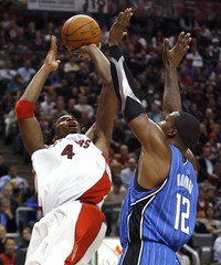Toronto Raptors forward Bosh shoots over Orlando Magic forward Howard during the first half of their NBA basketball game in Toronto