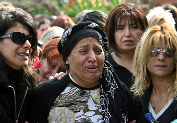 Family of Reut Feldman mourns her death during her funeral near Tel Aviv