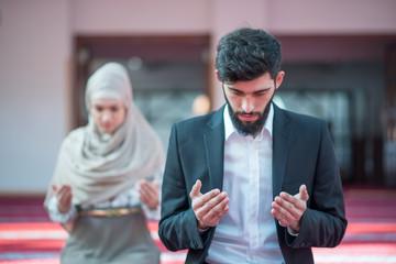 Muslim man and woman praying