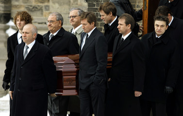 Wayne Gretzky and family members carry the casket of Gretzky's mother after funeral services in Brantford