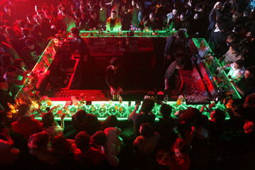 Guests hang out around the bar during a night out at the Baby Face night club in Shanghai