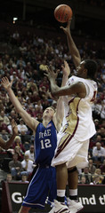 Florida State forward Reid shoots over Duke forward Singler in the first half of their NCAA basketball game in Tallahassee