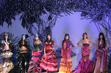 Models present creations at the China Fashion Week in Beijing