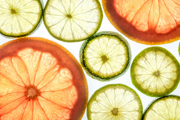 Bright lime and grapefruit slices on white