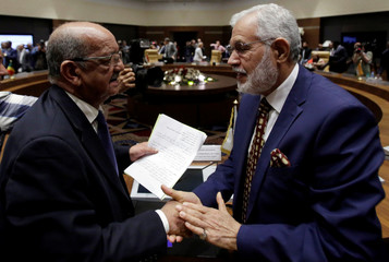 Libya's Foreign Affairs Minister Mohamed Taher Siala talks to Abdelkader Messahel, Algeria's Minister for African and Maghreb affairs during the meeting of Libya's neighbouring countries in Algiers