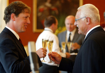 Czech President Vaclav Klaus toasts with newly appointed Czech Prime Minister Stanislav ...