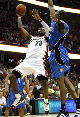 Cleveland Cavaliers' James tries to shoot over Orlando Magic's Howard during the second quarter of Game 5 of their NBA Eastern Conference Final basketball playoff game in Cleveland