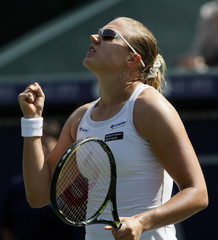 Kanepi of Estonia reacts after defeating Wozniak of Canada during their semi-final match at Japan Open tennis tournament in Tokyo