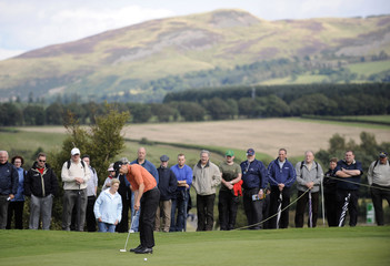 Fisher of England putts on seventh green during play at Johnnie Walker Championship golf tournament at Gleneagles, Scotland