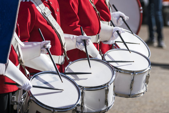 Drummers in red uniforms on a row