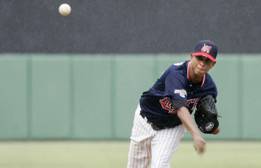 Venezuela's Jose pitches against Dominican Republic during their Caribbean Baseball Series game in Santiago