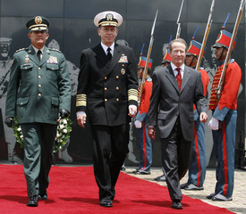 Colombian Armed Forces Commander General Padilla, U.S. Chairman of the Joint Chiefs of Staff, Admiral Mullen and U.S. Ambasador Browmfield walk during military ceremony in Bogota